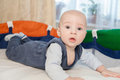 Baby in a baby cot cute plays Royalty Free Stock Photos