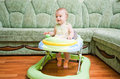 Baby in the baby walker Royalty Free Stock Photos