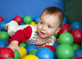 Baby in balls Royalty Free Stock Images