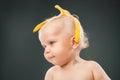 Baby with banana peel on head Royalty Free Stock Photo