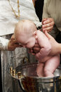 Baby baptism with water in font Stock Photo
