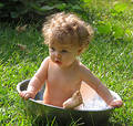 Baby in a basin Royalty Free Stock Images