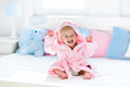 Image : Baby in bathrobe or towel after bath playing  first