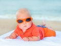 Baby on the beach cute laying sunbed at Royalty Free Stock Photography