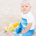 Baby on the beach cute tropical Stock Photo