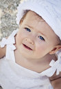 Baby at beach head and shoulders of cute on wearing hat Royalty Free Stock Photography