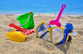 Baby beach toys on the sand against the blue sea Stock Photography