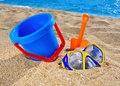 Baby beach toys on the sand against the blue sea Stock Image