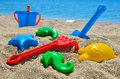 Baby beach toys on the sand against the blue sea Stock Photo
