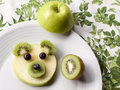 Baby bear face made of fruit, fun dessert for children Royalty Free Stock Photo