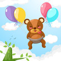 Baby bear flying with balloon Stock Photography