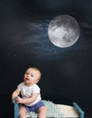 Baby bed time moon and starry night sitting in looking at stars against a dark blue background nap sleeping concept Stock Photography