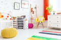 Baby bedroom with yellow pouf Royalty Free Stock Photo