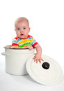 Baby in the big saucepan with cover Stock Images