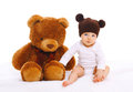 Baby with big teddy bear toy on white Royalty Free Stock Photo