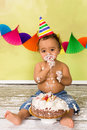 Baby with birthday cake adorable african during a smash on his first Stock Photo