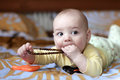 Baby biting beads Stock Photo