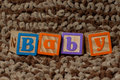 Baby blocks the word spelled out in kids building Royalty Free Stock Photos