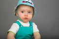Baby in a blue cap Royalty Free Stock Photo