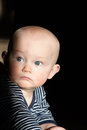 Baby with blue eyes looking to the side a boy crawling Royalty Free Stock Photography