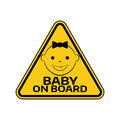 Baby on board sign with child girl smiling face silhouette in yellow triangle on a white background. Car sticker warning Royalty Free Stock Photo