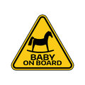 Baby on board sign with child horse silhouette in yellow triangle on a white background. Car sticker with warning. Royalty Free Stock Photo