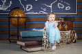 Baby with books and globe Royalty Free Stock Photo
