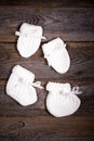 Baby booties and mittens Royalty Free Stock Photo