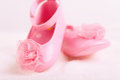 Baby booties shoes with rosette for newborn girl Stock Images