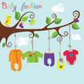 Baby born clothes hanging on the tree baby fashion colorful for newborn rope in branches slip body jacket sliders hats socks a bib Stock Photos