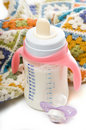 Baby bottle, pacifier and blanket Royalty Free Stock Photo