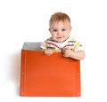 The baby in a box cheerful child Royalty Free Stock Image