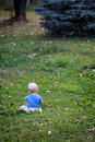 Baby boy alone on grass Royalty Free Stock Images