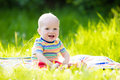 Baby boy with apple on family garden picnic Royalty Free Stock Photo