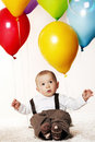 Baby boy with balloons. Royalty Free Stock Photo