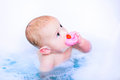 Baby boy in bath with a toy duck Royalty Free Stock Photo