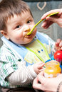 Baby boy being fed Royalty Free Stock Photo