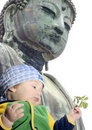 Baby boy below Great Buddah; Kamakura, Japan Stock Photography