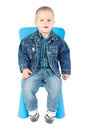 Baby boy on blue chair posing in studio Royalty Free Stock Photos