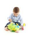 Baby boy busy playing with colorful developmental soft toy Stock Image