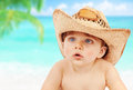 Baby boy in cowboy hat on beach closeup portrait of cute wearing big the happy summer holidays having fun outdoors Stock Photo