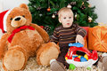 Baby boy discerning santa klaus at christmas Stock Photo
