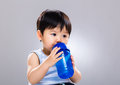 Baby boy drinking from bottle Royalty Free Stock Photo