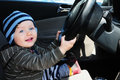 Baby boy driving Stock Images