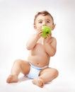 Baby boy eating apple Royalty Free Stock Photo