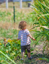 Baby boy exploring outdoor portrait of year old the surroundings of his yard Stock Photo