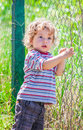 Baby boy exploring outdoor portrait of year old the surroundings of his yard Stock Photos
