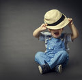 Baby Boy in Fashion Jeans, Hat Covered Eyes. Child Boy Beauty Royalty Free Stock Photo