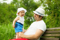 Baby boy and father adorable smiling boz with in the park Royalty Free Stock Image