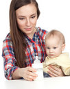 Baby boy is feeding by his mother Royalty Free Stock Photos